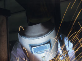 Welder in welding helmet