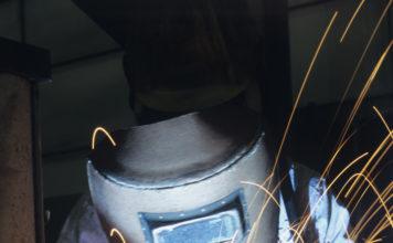 Welder in welding helmet
