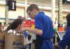 Thomas bagging groceries